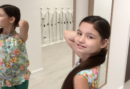 Mini Model Amelia Su-Lin Crawford gets ready to model Mini Me Fashions at Occasion Kids!